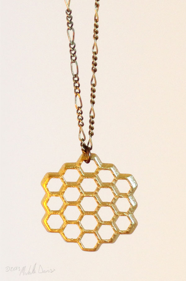 Hanging gold honeycomb pendant by michelle davis