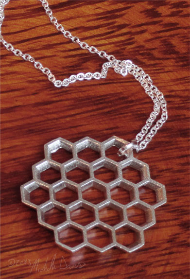 honeycomb silver pendant angled photo by michelle davis